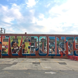 Five Points Postcard Mural (732 Saluda Avenue) by Chad Brady
