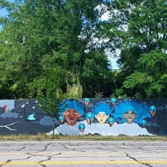 The Millwood Mural (2500 Millwood Avenue) by Cedric Umoja, Karl Zurfluh, Brandon Donahue, Ariel Flowers